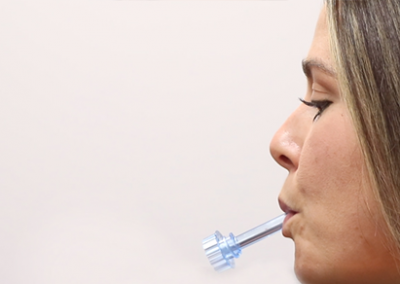 OralTox rapid oral fluid device photo. Donor holding the device in their mouth.